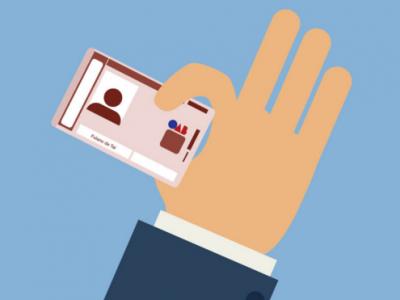 Ilustração mostra uma mão segurando carteira da OAB